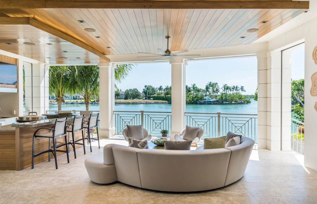 The luxury estate home located at 4395 Gordon Drive features a stunning outdoor living space to match the view