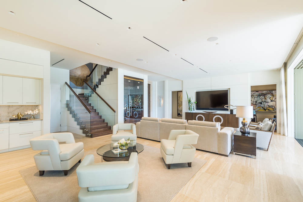 The great room of this Port Royal estate home features glass and wood pieces for an elegant contemporary design.