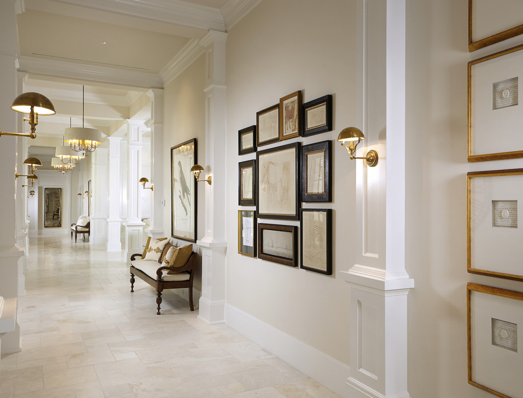 This luxury custom home features a cool transitional gallery wall by Romanza Interior Design.